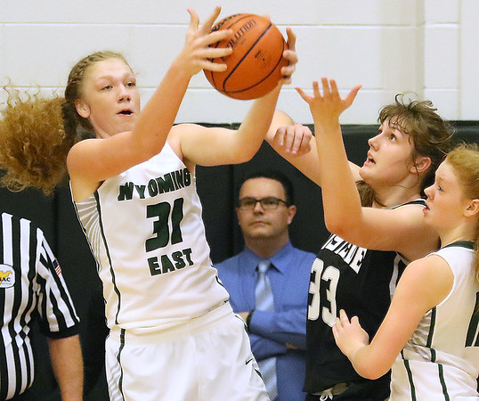 (Brad Davis/The Register-Herald) Wyoming East's Emily Saunders, left, and Westside's Morgan Thomas battle for a rebound Wednesday night in Clear Fork.