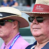 Mike Noe, left, of Lewisburg, with his brother, Larry Noe, of Lady Lake, Fl, watching play from the 17th hole during the second round of The Greenbrier Classic.<br /> (Rick Barbero/The Register-Herald.com