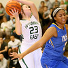 (Brad Davis/The Register-Herald) Wyoming East's Katie Daniels drives to the basket as St. Joseph Central's Kendra Ziegler defends during the Lady Warriors' win over the Irish Friday night in New Richmond.