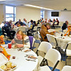 (Brad Davis/The Register-Herald) Eat-in attendance was high during Lewis Christian Community Center's Thanksgiving dinner Thursday afternoon in Oak Hill, while the center delivered well over a thousand meals around the area.