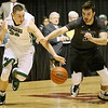 (Brad Davis/The Register-Herald) Independence's Logan Kelly and Wyoming East's Dylan Brehm race for a loose ball during Big Atlantic Classic action Wednesday night at the Beckley-Raleigh County Convention Center.
