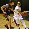 (Brad Davis/The Register-Herald) Bluefield's Donta Hopkins hustles around Poca's Jaycob Phillips during Big Atlantic Classic action Saturday afternoon at the Beckley-Raleigh County Convention Center.