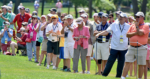 (Brad Davis/The Register-Herald) A hoard of fans follow the trio of Davis Love III, Robert Streb and K.J. Chol during second round Greenbrier Classic action Friday afternoon in White Sulphur Springs.
