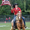 (Brad Davis/The Register-Herald) Young Indy equestrian Madison Deck speeds around the field during the national anthem Friday night in Coal City.