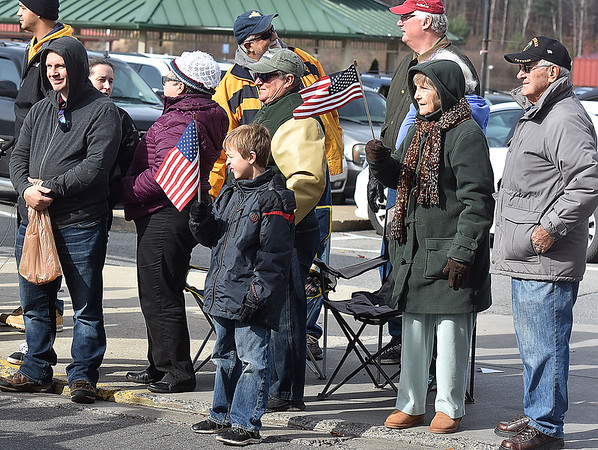 (Brad Davis/The Register-Herald) Residents take in the sights as they watch the city's annual Veterans Day Parade Saturday morning.