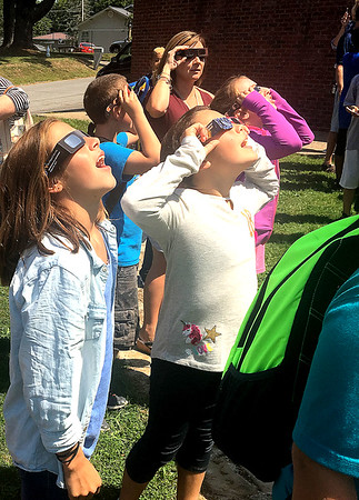Crescent Elementary students viewing the solar eclipse in front of the school on Crescent Road in Beckley Monday afternoon.<br /> (Photo by Jessica Farrish/The Register-Herald)