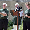 (Brad Davis/The Register-Herald) The names of all West Virginia victims are spoken Friday afternoon at Old Mill Park.