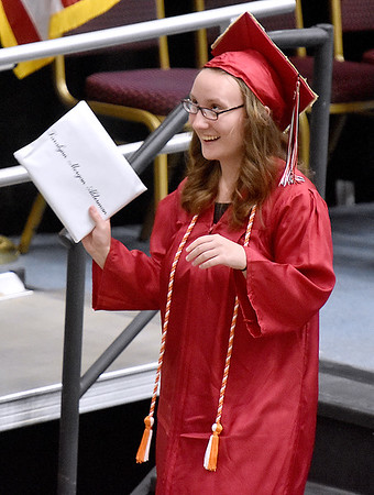 (Brad Davis/The Register-Herald) A Liberty senior reacts to cheers from friends and family during the school's 40th Commencement Saturday afternoon at the Beckley-Raleigh County Convention Center.