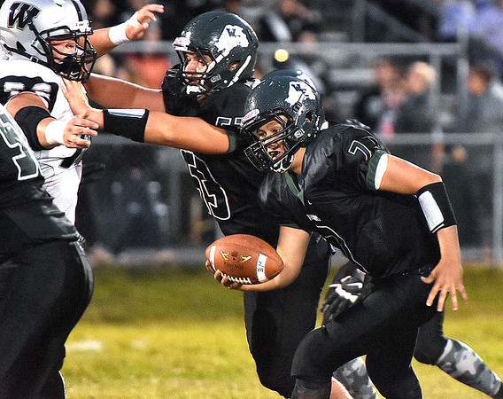 (Brad Davis/The Register-Herald) Wyoming East's Seth Ross carries the ball Friday night in New Richmond.