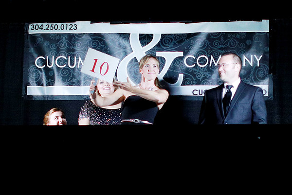 "Judge Amanda Barber holds a ""10"" after Morgan Walls and Cornett Stewart's performace during the 6th annual United Way of Southern West Virginia's Dancing With the Stars at the Beckley-Raleigh County Convention Center in Beckley on Friday. (Chris Jackson/The Register-Herald)"