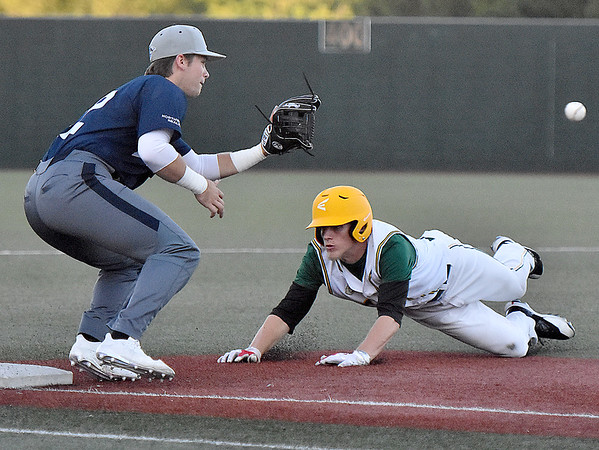 (Brad Davis/The Register-Herald) Miners baserunner Kyle Bergeron dives in to steal 3rd base after catching the Butler defense snoozing Friday night at Linda K. Epling Stadium.