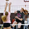 (Brad Davis/The Register-Herald) George Washington's Tessa Wyner, right, blasts a spike as her class AAA (Grey) All-Star team takes on Class AA (Pink) during the West Virginia North/South All-Star Volleyball event Saturday afternoon at Woodrow Wilson High School.