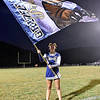 (Brad Davis/The Register-Herald) Nicholas County cheerleader Isabelle Weed waves a massive flag as they Grizzlies take the field for their road game at Westside Friday night in Clear Fork.