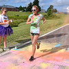 (Brad Davis/The Register-Herald) Haylei Davis crosses the finish line during the United Way of Southern West Virginia's annual Color Me United Walk/Run Saturday morning at the Raleigh County Memorial Airport.