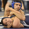 (Brad Davis/The Register-Herald) Princeton's Mohamed Addelwahed, above, takes on Richlands' Dakota Mintz in a 170-pound weight class matchup Saturday afternoon at Shady Spring High School. Princeton's Addelwahed would win the match.