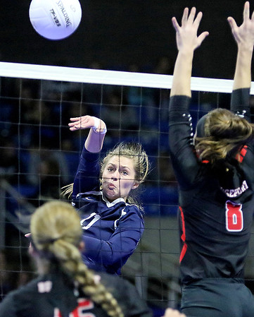 (Brad Davis/The Register-Herald) Shady Spring's Brooklyn Cook spikes the ball past Bridgeport's Juliet Hart during State Volleyball Tournament action Friday morning at the Charleston Civic Center.