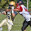 (Brad Davis/The Register-Herald) Shady Spring back Tyler Bragg is caught and tackled by Oak Hill's Ta'than Gray Saturday afternoon in Shady Spring.