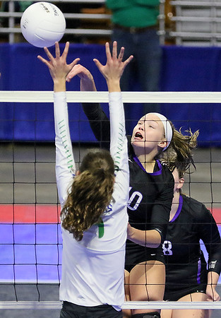 (Brad Davis/The Register-Herald) James Monroe's Gracie Mann rushes in to tap the ball across against Robert C. Byrd during State Volleyball Tournament action Friday afternoon at the Charleston Civic Center.