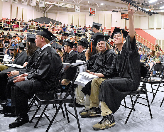 (Brad Davis/The Register-Herald) Summers County High School graduate Harley Mooneyhan (pointing) acknowledges cheering family and friends up in the stands as he and the rest of the 2017 class get their diplomas during the school's commencement ceremony Friday evening in Hinton.