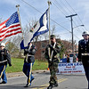 (Brad Davis/The Register-Herald) Members of Beckley's American Legion Post 32 color guard lead the way at the start of the city's annual Veterans Day Parade as it gets moving from Park Avenue towards Neville Street Saturday morning.