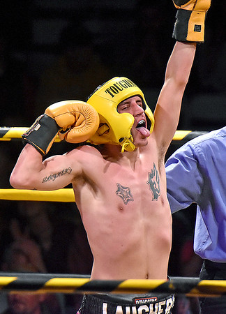 (Brad Davis/The Register-Herald) Oak Hill's Robert Laughery strikes a pose after being declared the winner of his first fight of the night against Ronaldo Dominguez during Original Toughman action Saturday night at the Beckley-Raleigh County Convention Center. Laughery went on to fight Oak Hill's Noah Pyatt fot the lightweight title.