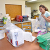(Brad Davis/The Register-Herald) Kiwanian Shelby Chapman organizes supplies Thursday evening as she and other members prepare for today's Kiwanis Pancake Day at First Christian Church on the corner of Fayette and Prince Street.