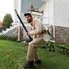 Civil War re-enactor Joseph Rose, from Pocahontas County, quickly gets up to hide behind a tree after firing a volley at the Federal Army during a battle between the local Home Guard and the Federal Army as part of Monroe County Heritage Day in Union on Saturday.  (Chris Jackson/The Register-Herald)