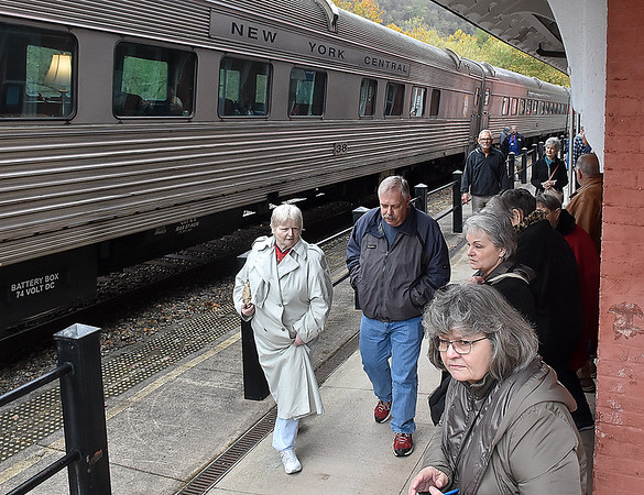 (Brad Davis/The Register-Herald) New River Train excursioneers hang out at the depot as they wait to set out on their return trip to Huntington during Hinton Railroad Days Sunday afternoon.