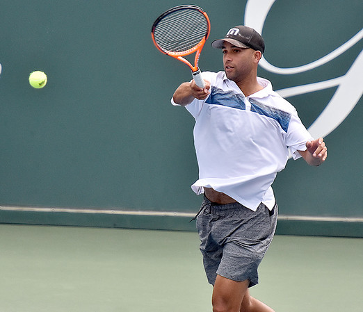 (Brad Davis/The Register-Herald) Retired tennis pro James Blake plays against Pete Sampras during the Greenbrier Champions Tennis Classic Saturday afternoon in White Sulphur Springs.