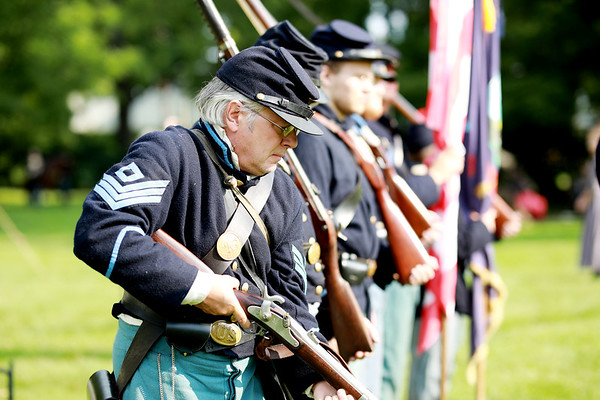 Civil War re-enactor Chris Johnson readies to aim his rifle during inspection at their camp prior to a skirmish between the local Home Guard and the Federal Army as part of Monroe County Heritage Day in Union on Saturday.  (Chris Jackson/The Register-Herald)