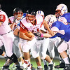 Oak Hill's Isaiah Newsom (44) tries to break a tackle from Midland Trail's Trevor Harrell (62) during their high school football game Friday in Hico. (Chris Jackson/The Register-Herald)