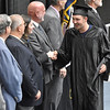 (Brad Davis/The Register-Herald) Graduates shake hands with school and county officials as they collect their certificates during the Academy of Careers and Technology's 2017 Awards ceremony Thursday night at the Beckley-Raleigh County Convention Center.