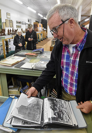 (Brad Davis/The Register-Herald) Willowdale, Ohio resident Rick Schulze takes a trip back in time as he browses the many thousands of authentic and historic photos inside the museum during Hinton Railroad Days Sunday afternoon.