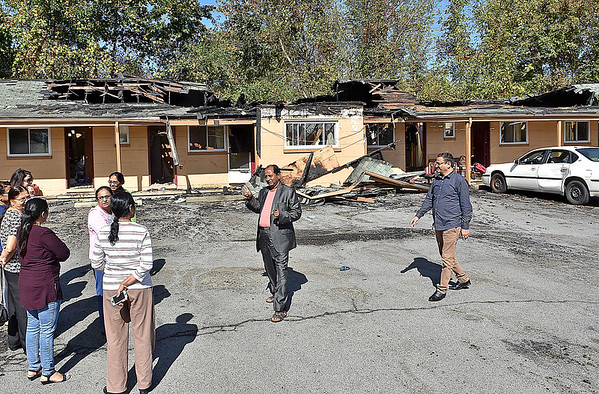 (Brad Davis/The Register-Herald) Neighbors and other curious nearby residents survey the damage at the Green Bank Motel Sunday afternoon after a fire that broke out there at around 11:15 p.m. Saturday night. No injuries were reported.