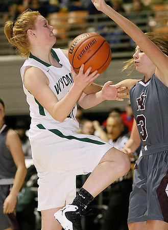 (Brad Davis/The Register-Herald) Wyoming East's Megan Davis drives and scores against George Washington during Big Atlantic Classic action Wednesday night at the Beckley-Raleigh County Convention Center.