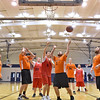 (Brad Davis/The Register-Herald) Special Olympics basketball teams from Raleigh County, dressed in red, and Fayette County, clad in orange, square off on the court inside Beckley's Van Meter Gymnasium during a local tournament Thursday evening. Both teams will be competing in the upcoming West Virginia Special Olympics state tournament and skills competition in Morgantown the weekend of March 11.