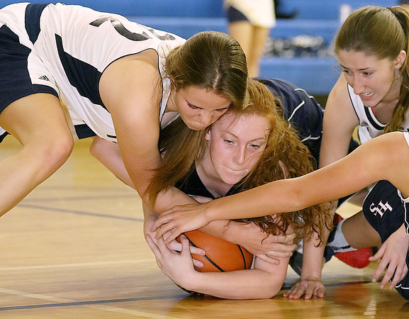 (Brad Davis/The Register-Herald) Shady Spring's Ashley Harding, left, and Independence's Alexis Bolen engage in a rugby-like scrum for a loose ball Thursday night in Shady Spring.