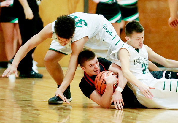 Webster County's Dalton Gray (12) dives for the ball over Fayetteville's Darrick McDowell (32) and (21) during their basketball game Tuesday in Fayetteville. (Chris Jackson/The Register-Herald)