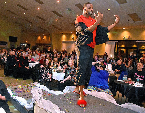 (Brad Davis/The Register-Herald) Participant Kelvin Pannell encourages the crowd as he takes the stage during the annual Hunks in Heels fundraising event for the Women's Resource Center Friday night at the Beckley Moose Lodge.
