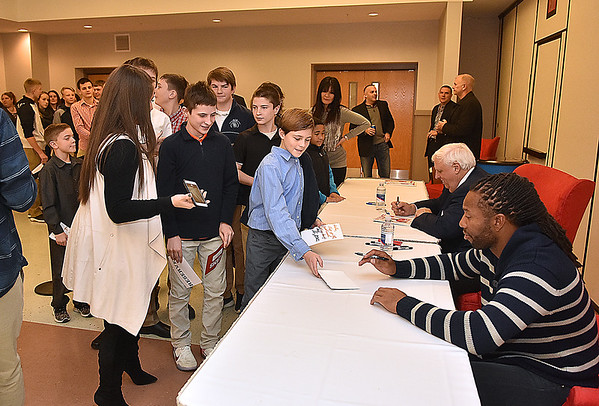 (Brad Davis/The Register-Herald) Fans young and old line up to get an autograph from Arizona Cardinals receiver Larry Fitzgerald following the Big Atlantic Classic Tip-Off Banquet Sunday afternoon at the Beckley-Raleigh County Convention Center.