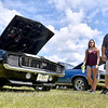 (Brad Davis/The Register-Herald) Victor residents John Holden, daughter Amber Fleshman and wife Taunya (hidden behind John) browse rides during the Friends of Coal Auto Fair July 15 at the Raleigh County Memorial Airport.