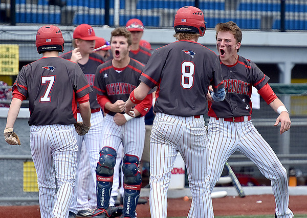 (Brad Davis/The Register-Herald) The Independence dugout erupts in celebration after Fisher Horton (#7) and Nick Kostenko (#8) came in to score late in the first game against James Monroe Friday afternoon at Linda K. Epling Stadium.