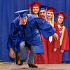 (Brad Davis/The Register-Herald) Graduating senior Josh Dickerson jokingly pretends to trip as he steps onto the stage to collect his diploma during Midland Trail's 41st Commencement Ceremony Friday night at the Summersville Armory.