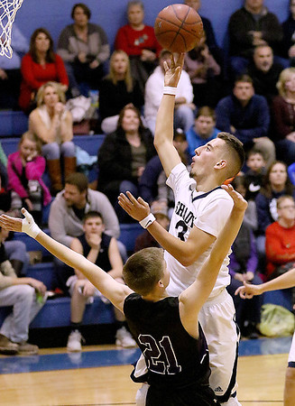 (Brad Davis/The Register-Herald) Shady Spring's Cole Honaker drives and scores as James Monroe's Remington Reece defends Wednesday night at Shady Spring Middle School.
