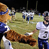 (Brad Davis/The Register-Herald) Nicholas County's Tanner Huffman gets a good luck high-five from the mascot as the Grizzlies take the field for their road game at Westside Friday night in Clear Fork.