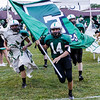 Fayetteville Quarterback, Tristian Coots, leads the Pirates on to the field. Chad Foreman for the Register-Herald.
