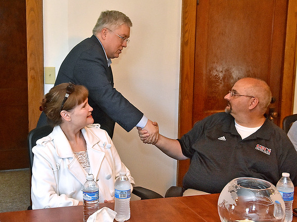 (Brad Davis/The Register-Herald) Attorney General Patrick Morrisey is greeted by Delegate Lynn Arvon, left, and Greater Beckley Christian School administrator Charles Atkins as he arrives for a roundtable discussion on addiction and sunstance abuse with local leaders at the One Voice office on Kanawha Street Friday afternoon.