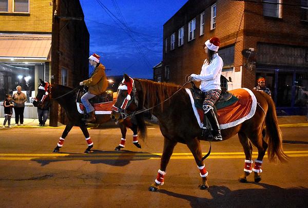 (Brad Davis/The Register-Herald) Scenes from the Oak Hill Christmas Parade Saturday night.