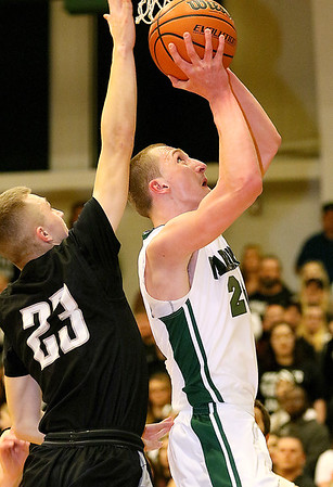 (Brad Davis/The Register-Herald) Wyoming East's Zachary Cook drives and scores as Westside's Jacob Ellis defends during the second boys meeting of the year in the battle for Wyoming County Friday night in New Richmond.