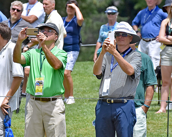 (Brad Davis/The Register-Herald) Fans break out the smartphones as they follow the trio of Phil Mickelson, Bubba Watson and defending champ Danny Lee during first round Greenbrier Classic action Thurdsay afternoon in White Sulphur Springs.